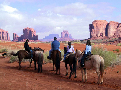 Photo of horseback riders in Monument Valley Navajo Nation Park