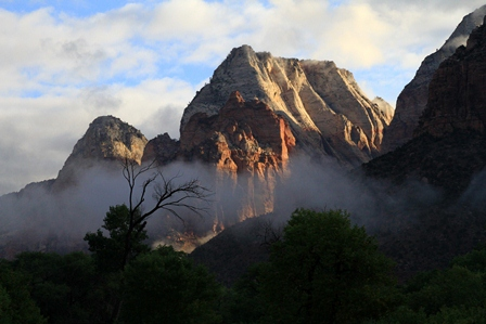 Photo of Zion National Park in early morning light with low hanging clouds